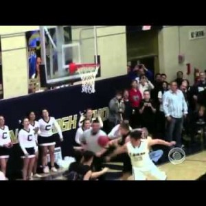 Touching moment basketball player from opposite team hands ball to disabled player